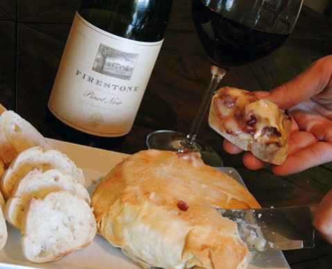 Pure Joy's Caramelized Onion, Pinot Noir, and Cranberry Filled Brie en Croute