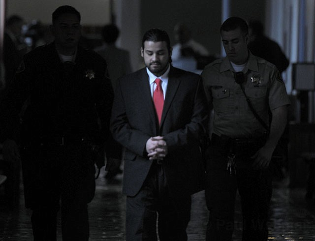 Adrian Robles leaves the courtroom after a jury found him guilty of first-degree murder in the 2010 stabbing death of Robert Simpson