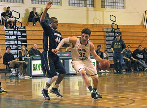 Emilio Gonzalez (32) of the Santa Barbara Dons drives around Chadd Cosse of Flintridge Prep in the Holiday Classic championship game.