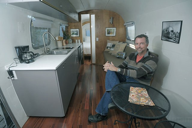 Wally Hofmann of Hofmann Architecture in one of his custom refurbished Airstream trailers available for rent at the new Santa Barbara Auto Park.