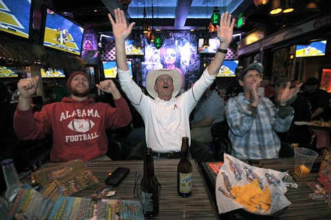 FROM LEFT: Alabama natives Cody, Mike, and Mike cheer on Alabama's Crimson Tide defeating the Notre Dame Fighting Irish at Sharkeez.