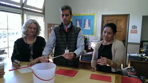 Left to right: Holly Christopher Muñoz, Principal Demian Barnett, and Maria Cruz