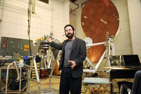Professor Philip Lubin stands in a physics department workshop.