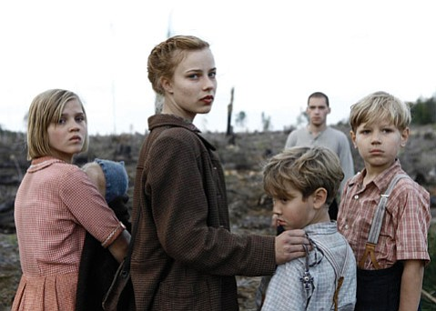 Relying on a Jewish refugee, a German girl (Saskia Rosendahl, center) and her siblings wend their way through post-Hitler Germany in <i>Lore</i>.