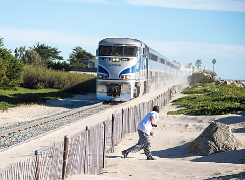 This woman narrowly avoided a northbound Pacific Surfliner train barreling along the beach near Santa Claus Lane.