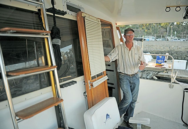 Duane Landis has worked and lived in the harbor for decades and doesn't like the sound of the newly proposed parking rules.