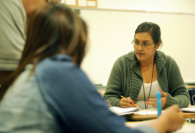 Teaching assistant Sonia Manzo worked with students this week at El Puente school.