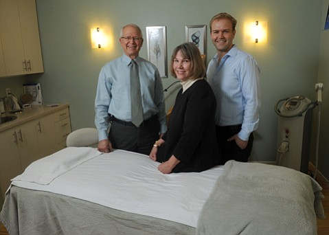 The Perkins family at Evolutions Medical and Day Spa. From left to right: Terry, Linda, and Brian