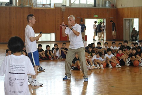 Gary Colson (right), a former UCSB athletics administrator and college basketball coach, showed kids in Japan