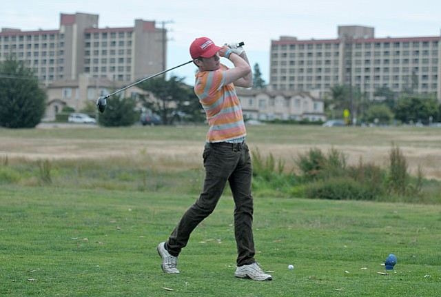 A golfer teed off at the now-closed Ocean Meadows Golf Course.