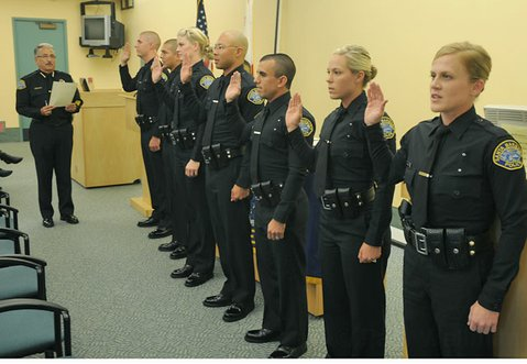 Police chief Cam Sanchez swears in seven new police officers to the SBPD. From left to right: Ryan Aijian, John Barriga, Cynthia Carter, Michael Chung, Dominic Flores, Kaitlyn Heinz, and Kendall Russell