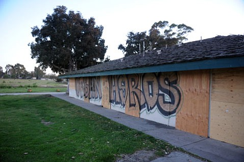 """<b>PLANNING FAST: </b> Days after being boarded up, graffiti vandals hit the Ocean Meadows clubhouse, and the new overseers are quickly determining how to best protect the property. """"There is danger of this being a little free-for-all initially,"""" said UCSB's Carla D'Antonio. """"That's why the campus wants to get in there right away and let the public know what's going on."""""""