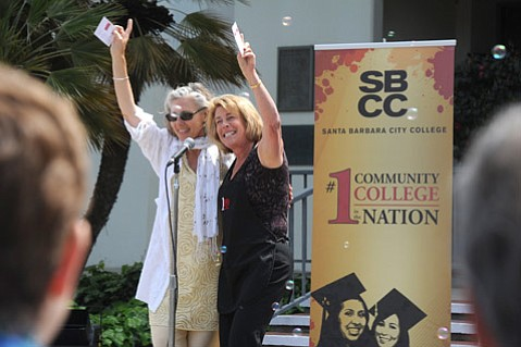 """<b>WE'RE NUMBER ONE!</b>  SBCC President Lori Gaskin (right) and Dean Alice Scharper sung a modified version of The Beach Boys' """"Be True to Your School"""" at a campus celebration of the Aspen Prize victory."""