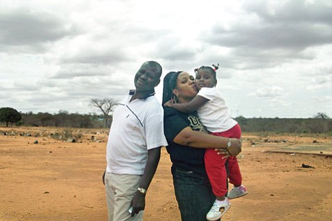Dr. Lilyann Katiwa-Oyugi, her husband, Joseph, and one of their young daughters in Kenya.