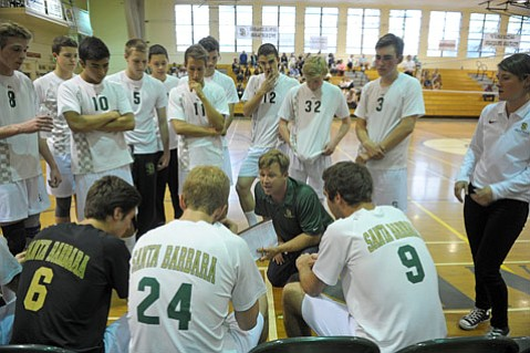 <b>MONSTERS AT THE NET:</b> Santa Barbara High's boys volleyball team huddles up to hear words of wisdom from Coach Chad Arneson (pictured center, kneeling) during a match. The Dons recently won their ninth consecutive season championship against Dos Pueblos High.