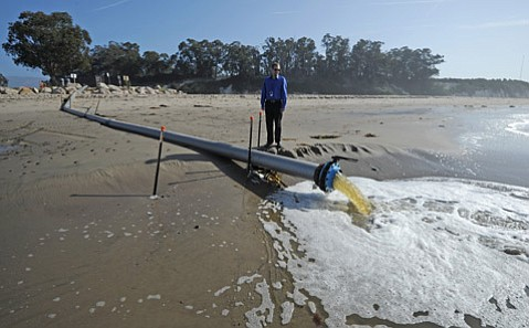 <b>QUICK FIX: </b> The City of Santa Barbara's airport planner Andrew Bermond stands next to the siphon installed to drain off some of the Goleta Slough, whose high waters are causing problems for airplanes and a boost in mosquitoes.