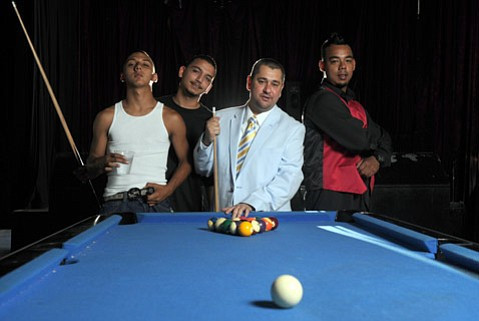 """<b>805 HIP-HOP HEROES:</b> Former deejay and longtime music producer Damion """"Damizza"""" Young (in blue) is cultivating Santa Barbara's own rap talent, including Fresh (in red vest), Lil Bams (white tank top), and Kidd (black shirt)."""