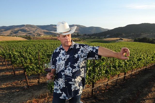 Peter Work of Ampelos Cellars describes checking the moisture content of the grape vines.