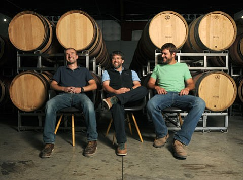 "<b>TALKIN' 'BOUT THE GHETTO:</b> The collaborative, workshop-like atmosphere of the Lompoc Wine Ghetto is what has allowed Sashi Moorman (middle) to take on multiple projects under his own winemaking business, Provignage, which employs winemaker John Faulkner (left) and partners with vineyard expert Chris King (right) of Cosecha Farming. ""Without this place,"" said Moorman, ""I wouldn't be able to do what I'm doing now."""