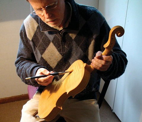 <b>KEEPING IT REAL:</b>  Luthier Brian Lisus uses only 16th-century methods and materials to create his stringed instruments.