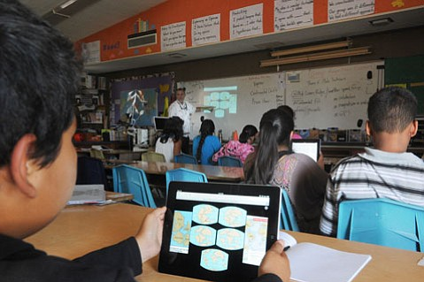 <b>STUDENT BECOMES TEACHER:</b>  In Kevin O'Sullivan's science class at Cleveland Elementary School, students educate each other about plate tectonics by projecting from their iPads.