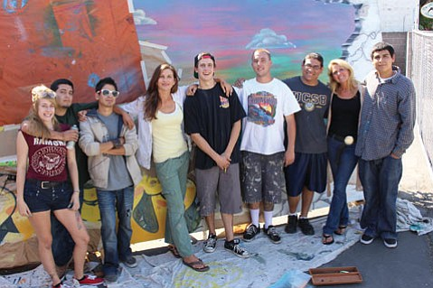 <b>WORKING TOGETHER:</b>  Youth Interactive artists (from left) Rachel Walsh, Jonathan Hernandez, Jake Anderson, Colette Cosentino, Miles Sherwood, Toby Trout, Gabriel Melgar, Nathalie Gensac, and Alex Orozco pose in front of their mural-in-progress.