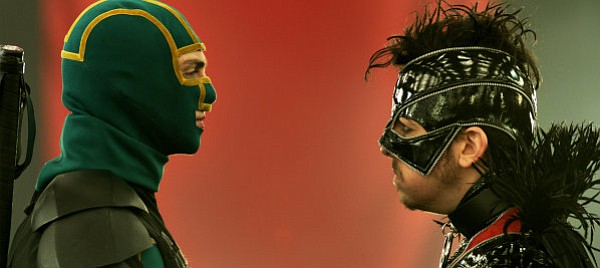 Aaron Taylor-Johnson (left) stars as a comic book nerd-turned-superhero who squares off against foe The Motherf---er (Christopher Mintz-Plasse) in <em>Kick-Ass 2</em>.