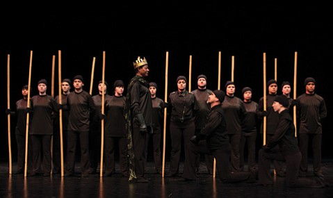 <b>ROYALTY BETRAYED:</b> Duncan (Michael Morgan, center) grants Macbeth (Jeff Mills, center right) the title Thane of Cawdor in front of the king's soldiers.
