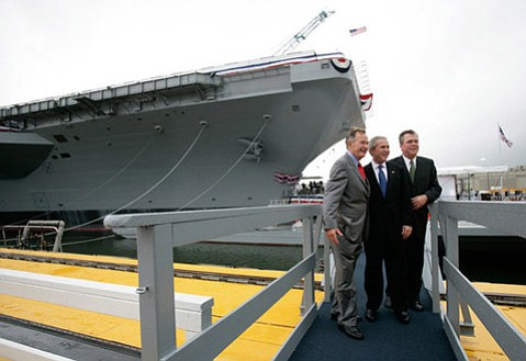 G.H.W. (left), G.W., and Jeb Bush at the christening ceremony of the <em>George H.W. Bush</em> Nimitz-class supercarrier in 2006.