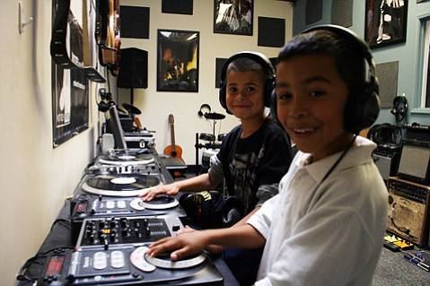 <b>FUTURE SOUNDS:</b>  Notes for Notes students man the turntables at the organization's Eastside Music Box.