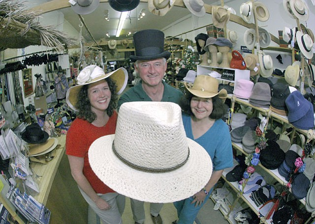 Family-owned Green & Yellow Basket: (L to R) Kelly Metcalf with parents Ed and Susan Dogherty (Oct. 14, 2004)