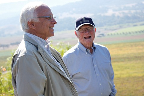 "<b>LOUIS & ROYCE:</b>  Louis (pronounced ""Louie"") Lucas (left) and his partner Royce Lewellen overlook the Valley View Vineyard as it slopes toward the Santa Ynez River."