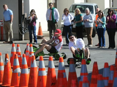 City Administrator Jim Armstrong and his assistant Marcelo Lopez race during a fundraiser for United Way