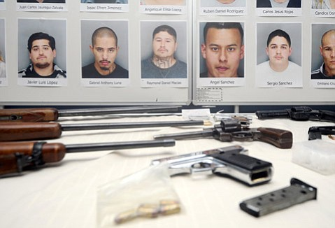<b>NAME AMONG NAMES: </b> Police made special note of the recent arrest of Raymond Macias (mug shot pictured above center), a defendant on the city's proposed gang-injunction list and the former Eastside program coordinator for La Palabra, ​a nonprofit working with at-risk youth.  (Nov. 20, 2013)