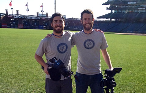 Isaac (left) and Jacob Seigel-Boettner on the field at AT&T Park during a day of filming Batkid saving San Francisco.