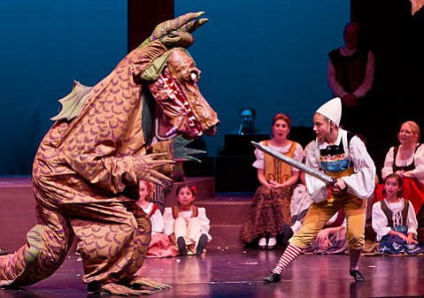 <b>LUCKY DRAGON:</b>  Robby Robbins brings back Draco the Dragon this year, here seen with performer Natascha Skerczak.