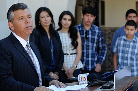 Former Lt. Gov. Abel Maldonado announces that he is dropping out of the California governor race as his family listens at Santa Maria City Hall Thursday.
