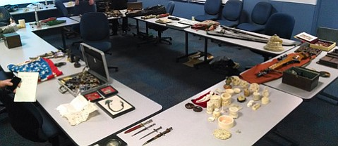 Police display the items allegedly stolen by Sela