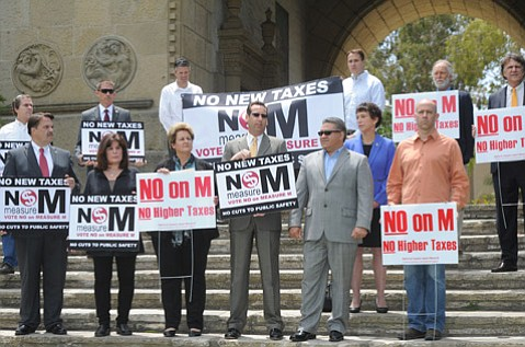 <b>MASS OPPOSITION:</b>  (from left) Sheriff Bill Brown; Supervisors Janet Wolf, Doreen Farr, Steve Lavagnino, and Salud Carbajal; DA Joyce Dudley; and others gathered at the county courthouse for the second of two No on Measure M events this Monday.