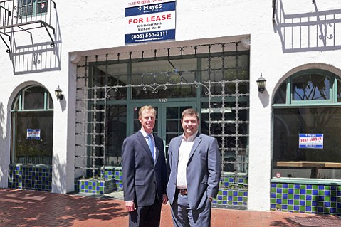 Commercial real estate agents Michael Martz (left) and Kristopher Roth stand in front of 530 State Street, soon to be home to Samy's Camera.