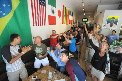 "<b>THE THRILL OF VICTORY:</b> Patrons at Brasil Arts Café (pictured) on State Street jumped to their feet with elation after the U.S. soccer team beat its old adversary, Ghana. It assured that the U.S. will be in contention to advance in the tournament through the remainder of its ""Group of Death"" matches versus Portugal on Sunday and Germany on Thursday."