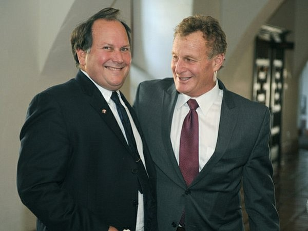 Darryl Genis (left) celebrates with his attorney Michael Fremont after Judge Geck's ruling (Aug. 1, 2014)
