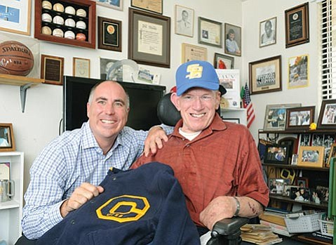"BIDDING ADIEU:  After six years as UCSB's athletics director, Mark Massari (above left) is heading north to start his new job as deputy director of athletics at Oregon State. Before departing, Massari presented longtime fan ""Mr. Gaucho"" Phil Womble with a letterman's jacket."