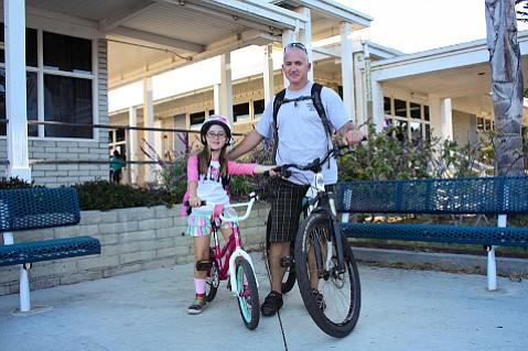 Reta and Sean Callihan ride to school each morning.