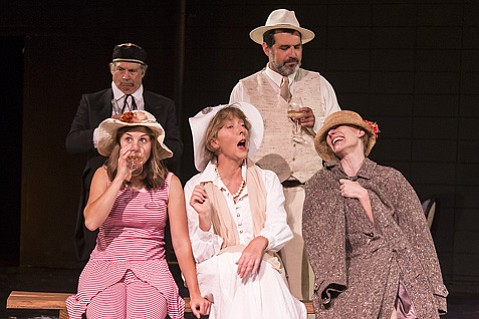 <b>FAMILY MATTERS:</b>  Stan Hoffman (left) and Michael Bernard stand behind the mother (Victoria Finlayson, center) and her daughters (Lauren White, left, and Nina Sallinen) at the center of Chekhov's The Cherry Orchard.
