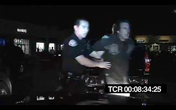 The city has settled the Cotledge and Denunzio federal cases. This still from a patrol car shows Tony Denunzio's arrest in 2011.