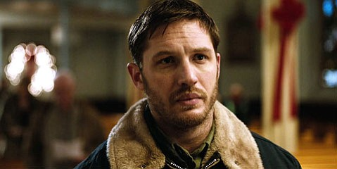 <b>RAISING THE BAR:</b>  Tom Hardy steals the show as Bob, a puppy-loving Brooklyn bartender working at a mob-controlled dive, in <i>The Drop</i>.