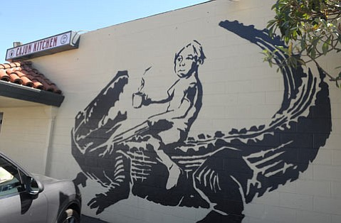 """<b>BAD BOY:</b>  Painted without permits, the mural """"Gator Boy"""" was ordered removed by the Historic Landmarks Commission; the appeal is pending."""