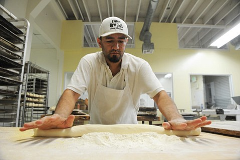 Ricardo Villalpando rolling out dough at Ethnic Breads.