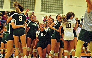 The Dons celebrate their three-set sweep over rival San Marcos.